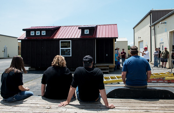 Two tiny houses are auctioned at Crowder Technical Education Center on Tuesday afternoon.<br /> Globe | Roger Nomer