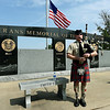 Bagpiper Joel Wren, of Aurora, pays tribute to veterans during a special Memorial Day service at Mount Hope Cemetery.<br /> Globe | Laurie Sisk