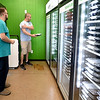 WorkFresh employee Adam Marold, right,  assists customer Stephen Rose as he looks through the variety of freshly prepared meals at the WorkFresh store on East Seventh Street on Friday. The business offers about 20 meal options using fresh ingredients.<br /> Globe   Laurie Sisk