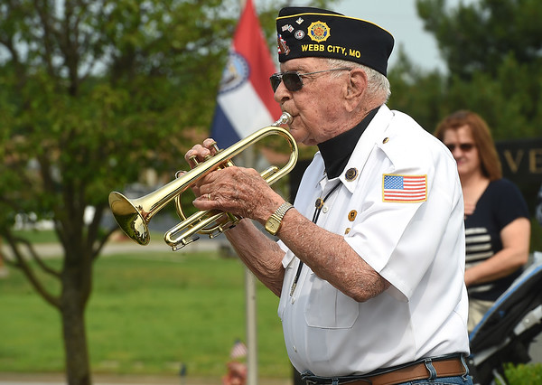 """Bruce Benson plays """"Taps"""" during a special Memorial Day service at Mount Hope Cemetery.<br /> Globe 