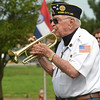 "Bruce Benson plays ""Taps"" during a special Memorial Day service at Mount Hope Cemetery.<br /> Globe 