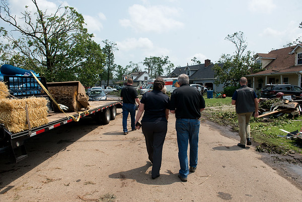 Sandy Karsten, Missouri director of the Department of Public Safety, talks with Missouri Gov. Mike Parson during a tour of the Briarbrook neighborhood on Thursday.<br /> Globe | Roger Nomer