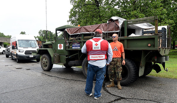 From the left: Jim Hart, of the American Red Cross and Larry Jordan, of Guardian Relief, chat in a staging area for recovery workers on Thursday at Briarbrook Country Club. Numerous organizations pitched in to help with cleanup and recovery efforts after a tornado struck the Carl Junction area on Thursday night.<br /> Globe | Laurie Sisk