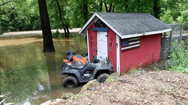 Flood waters that once rose halfway up a shed in Royal Heights are pictured as the water receded later Thursday. Several homes on Jaccard Street were flooded after Turkey Creek breached its banks on Thursday morning.<br /> Globe | Laurie Sisk