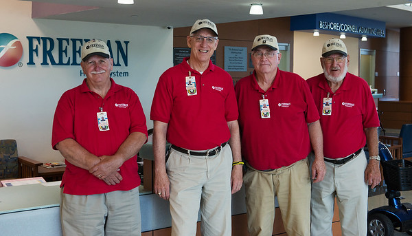 (from left) George Reeve, Jim Rhea, Gary Casteel and Lee Roy Cristy volunteer with the Freeman Auxilary on Friday at Freeman Hospital.<br /> Globe | Roger Nomer