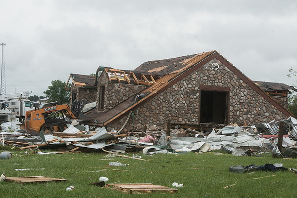 A house is damaged by a tornado on the Hughes' property near Wheaton on Wednesday.<br /> Globe | Roger Nomer