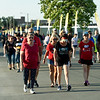 Walkers make their way down Joplin Street, past flags memorializing the 161 victims of the May 2011 tornado during the Memorial Walk of Silence on Friday night.<br /> Globe | Laurie Sisk