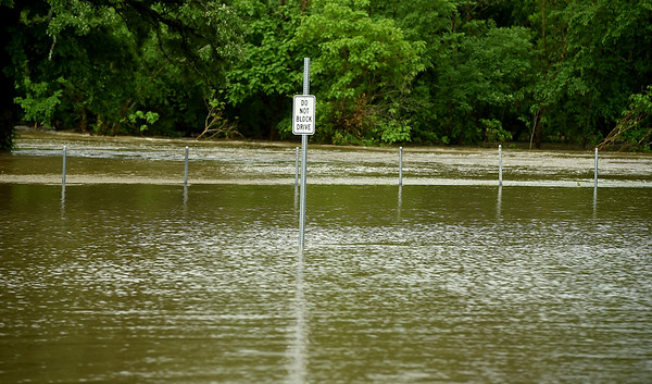 Flood waters from Center Creek form a strong current at Frank Dean Sports Complex near Carl Junction's Center Creek Park on Thursday morning.<br /> Globe | Laurie Sisk