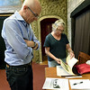 From the left: Donald Clarke and Paula Callahan look through historic photos of east Joplin during  the Post Art Library's East Town Show and Tell project on Tuesday night at Boookhouse Cinema.<br /> Globe | Laurie SIsk