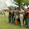 Capt. Brian Cox, left, of the 9th Texas Civil War reenactors, runs musket volley fire drills with reenactors from various local groups on Saturday during VFW Post 781's Living History Day at Carl Junction Memorial Park. <br /> Globe | Laurie Sisk