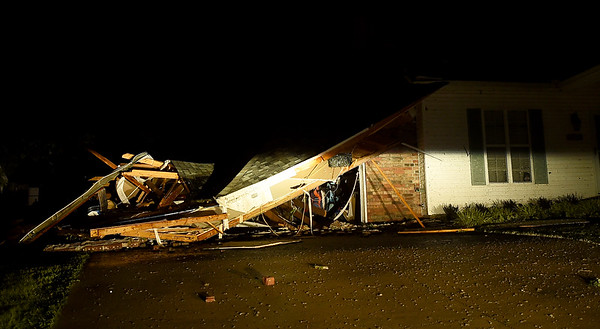 A garage lay demolished after a large tornado hit on Tea Street near Briarbrook in Carl Junction on Wednesday night.<br /> Globe | Laurie SIsk