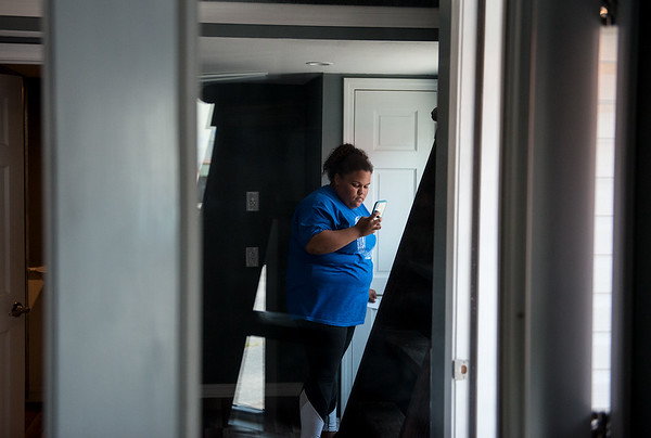 Breanna Burge, Neosho High School senior, takes last photos of the tiny house she helped design at Crowder Technical Education Center on Tuesday.<br /> Globe | Roger Nomer
