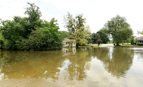 A neighborhood near 1st SW St.  and E SW St. remains submerged in water from the Neosho River as much of the southside of Miami remained underwater on Tuesday. Though the waters have receded, many areas of the town are still under water and numerous streets and roads remain closed. More rain is expected in the area in the coming days.<br /> Globe | Laurie SIsk