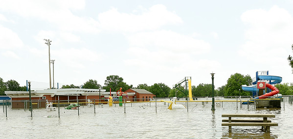 The Miiami Municipal Pool sits submerged in flood waters from the Neosho River as much of the southside of Miami remained underwater on Tuesday. Though the waters have receded, many areas of the town are still under water and numerous streets and roads remain closed. More rain is expected in the area in the coming days.<br /> Globe | Laurie SIsk