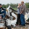 Stephanie Hughes talks with her husband Bob and son Tyrek Powell after looking at tornado damage on their property on Wednesday near Wheaton.<br /> Globe | Roger Nomer