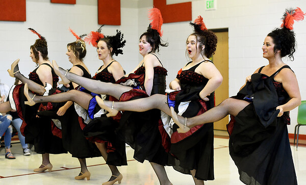 The Spring River Saloon Girs entertain the crowd during the Cowtown Spring Fling Saloon Show on saturday at Baxter Springs' Lincoln Elementary. About 12 performers from the Cherokee County Arts Association combined for four saloon shows on Saturday. The two-day Spring Fling also featured vendors, a car show, live music and more. Globe | Laurie Sisk