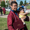 "Erik ""Chancho"" Velazquez poses for a photo with his diploma at niece Ameila Marquez, 10 months, following Sunday's Joplin High School graduation ceremony at the Leggett and Platt Athletic Center.<br /> Globe 