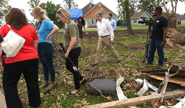 Sen. Roy Blunt walks amongst the debris on Wednesday as he visits with those affected by the Carl Junction tornado.<br /> Globe | Laurie SIsk