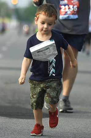 Three-year-old Ryker Hare, of Jenks, Okla., runs in memory of the older brother he never met during the Joplin Memorial Run on Saturday at Memorial Hall. Ryker's older brother, Lantz Hare, was among the 161 people who died in the May 2011 tornado. Lantz was on his way to find his other brother, Matt Hare, when he was killed.<br /> Globe   Laurie Sisk