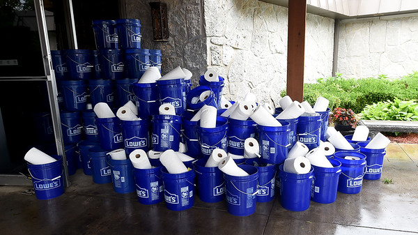 Buckets and paper towels await those waiting to clean up after a tornado struck the Carl Junction area on Thursday night.<br /> Globe | Laurie Sisk