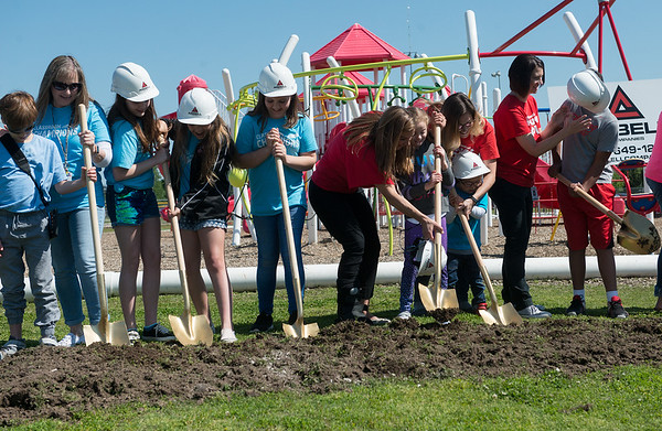 Carl Junction students help break ground for an inclusive playground on Monday in Carl Junction.<br /> Globe | Roger Nomer