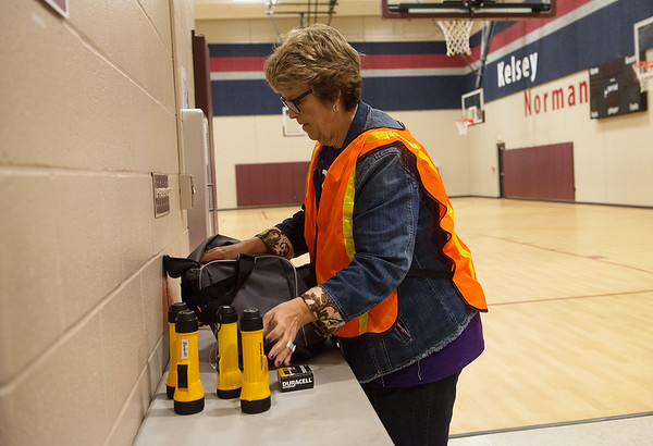 Kay Johnson talks about emergency equipment at the community shelter at Kelsey Norman on Tuesday.<br /> Globe | Roger Nomer