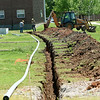 Liberty Utilities workers dig a trench for an additional primary powerline in preparation for expansion of residence hall parking on Thursday at Missouri Southern.<br /> Globe | Laurie Sisk
