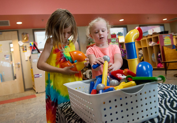 Charlee Wheeler, left, and Bailey Russow play during summer school on Friday at Soaring Heights Elementary. The duo will be entering kindergarten next year.<br /> Globe | Roger Nomer