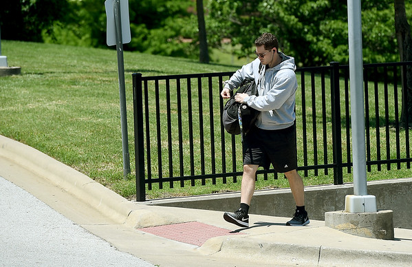 Missouri Southern student Jaxkson Parks makes his way to the Beimdiek Recreation Center for a workout on Thursday as he awaits the start of the summer semester.<br /> Globe | Laurie Sisk