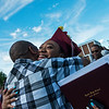 Malia Mack gets a hug from her father Christopher following Sunday's Joplin High School graduation ceremony at the Leggett and Platt Athletic Center.<br /> Globe | Roger Nomer