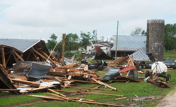 Barns are damaged by a tornado as seen on Wednesday near Wheaton.<br /> Globe | Roger Nomer
