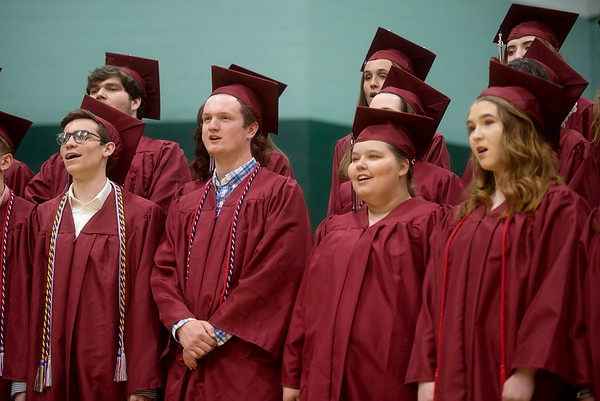 "Senior choir members sing ""For Just a Little While"" during Sunday's Joplin High School graduation ceremony at the Leggett and Platt Athletic Center.<br /> Globe 