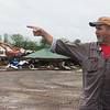 Bob Hughes talks about the arrival of a tornado on his property south of Wheaton during an interview on Wednesday.<br /> Globe | Roger Nomer
