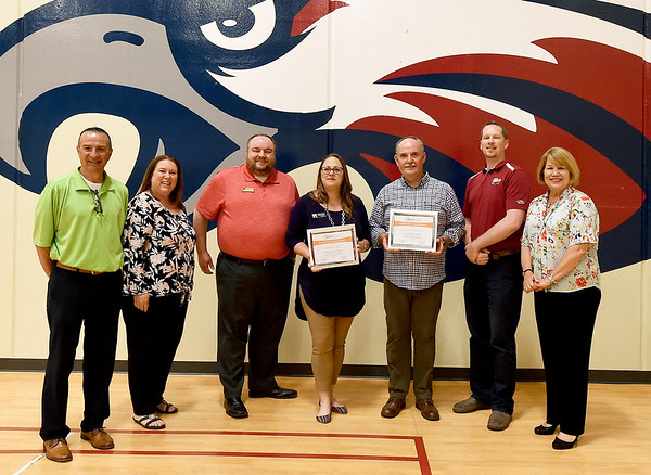 From the left: Bright Futures board member Duane Dreiling, East Moreland Principal Heather Surbrugg, Brad Page and Nicole Hopper, assistant vice presidents for Mid Missouri Bank, Second Assembly of God Pastor John Veazey, Jefferson Elementary Principal Jason Weaver and Bright Futures board member Peggy Fuller stand with the May Bright Futures awards for partnerships with the two schools on Tuesday at East Moreland School.<br /> Globe | Laurie Sisk