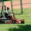 Brian Roark, of the Missouri Southern Athletic Department, mows the grounds of the Pat Lipira Softball Complex on Thursday at MSSU.<br /> Globe | Laurie SIsk