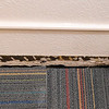 Beneath floor trim, evidence of separation between the wall and the floor for most of the width of a classroom on the second floor of Columbia Elementary is evident.<br /> Globe | Laurie Sisk