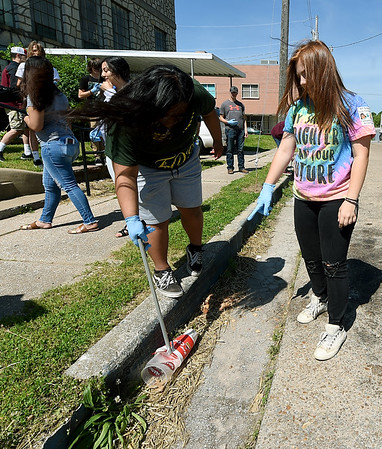 Darleene Edward, left and Emily Iseli clean up trash around the Neosho High Schoool Jefferson Street Campus on Thursday. Iseli serves as student director of the Clean Community Project.<br /> Globe | Laurie Sisk