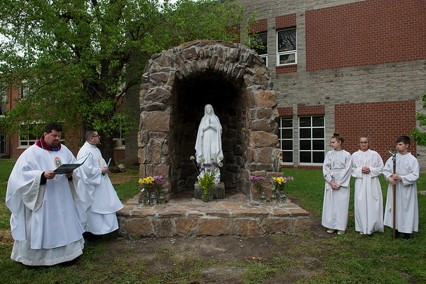 Clergy and students participate in the May crowning ceremony on Thursday at the McAuley grotto.<br /> Globe | Roger Nomer