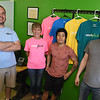 From the left: WorkFresh employees Adam Marold, Salena Tate, Reiden Tizon and owner Jason Williams pose for a photo at the WorkFresh store on East Seventh Street on Friday. The business offers about 20 meal options using fresh ingredients.<br /> Globe | Laurie Sisk