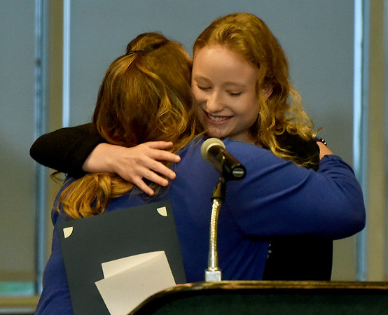 McAuley teacher Amanda Walker, left hugs McAuley student Madison Szell during the 33rd Annual Joplin Globe All-Area Academic Excellence Team Honor Banquet on Thursday night at Missouri Southern. Szell was one of 20 area students honored at the event. Globe | Laurie Sisk