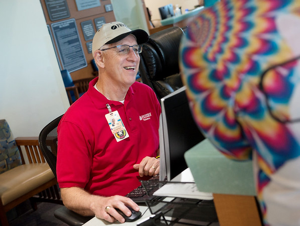 Jim Rhea helps out a visitor to Freeman Hospital on Friday.<br /> Globe | Roger Nomer
