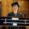 Gavin Currey displays an Air Force Academy sword owned by his great uncle Enos Currey, who graduated with the first class from Joplin Junior College in 1939.