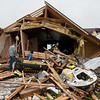 Friends and family helps clean up tornado damage on the Hughes' property, south of Wheaton, on Wednesday.<br /> Globe | Roger Nomer