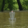 Hole no. 2 on the Ozark Christian College disc golf course lay submerged in several feet of water after flooding on Thursday morning.<br /> Globe | Laurie Sisk