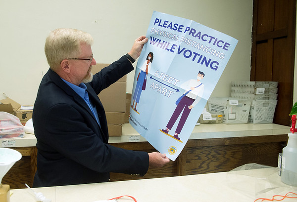 Charlie Davis, Jasper County Clerk, talks about posters that will be seen at polling locations on Wednesday at the Jasper County Courthouse in Carthage. Globe | Roger Nomer