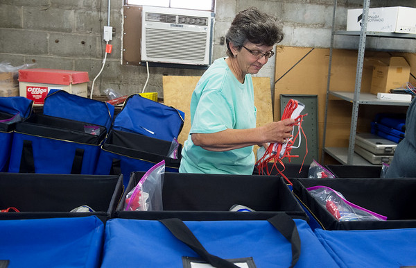Pam Stines distributes face masks for sanitation kits for polling places in preparation for Tuesday's elections on Thursday at the Jasper County Records Center. Globe | Roger Nomer