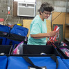 Pam Stines distributes face masks for sanitation kits for polling places in preparation for Tuesday's elections on Thursday at the Jasper County Records Center.<br /> Globe | Roger Nomer