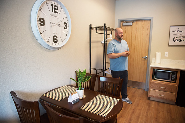Matt Ingle, director of the Washington Hope Center,give a tour of a family room at the center on Tuesday. Globe | Roger Nomer