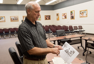 Ron Lankford talks about the original All-Area Academic Committee in a photo from 1987 during an interview on Thursday at the Memorial Education Center. Globe   Roger Nomer