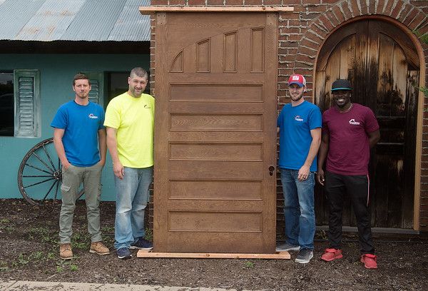 A crew from Taylor Brothers Construction, including (from left) Isaiah Puckett, Robert Taylor, Jeremiah Taylor and Richard Ferguson, removed the original Schifferdecker House doors from Del Rio and remade a new set for the restaurant.<br /> Globe | Roger Nomer